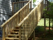 A new, longer stairwell was created to replace a short stairwell on the opposite side.
